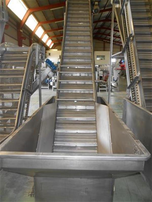1 elevador de cangilones con balsa. descarga 3 m