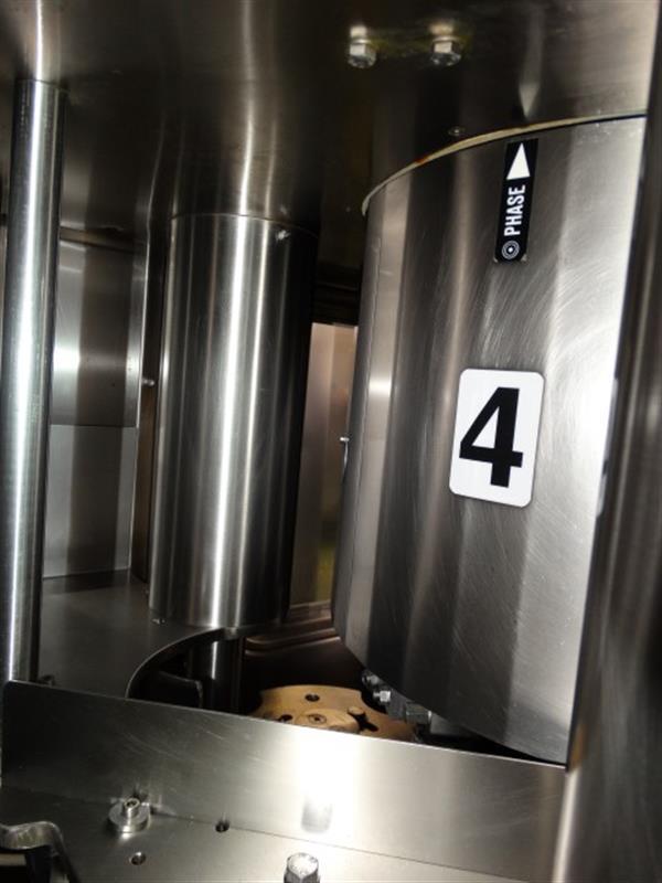 5 cerradora sima de 4 cabezales con grupo de llenado de 16 pistones hema
